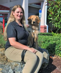 bayside pet resort dog trainer sitting with golden retriever